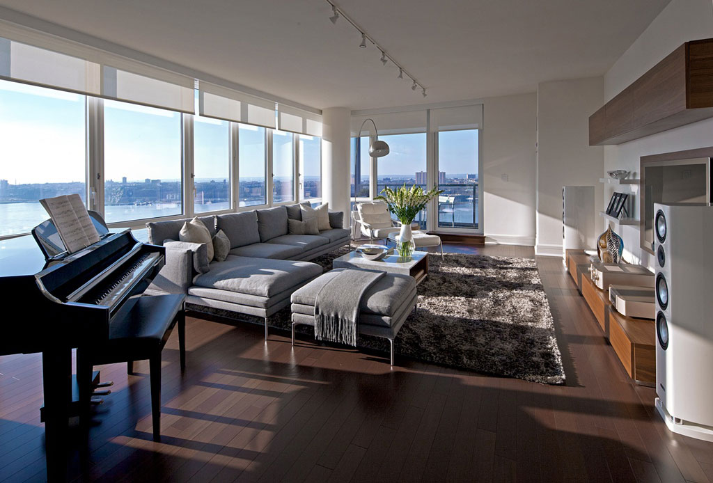 This new york city apartment featured floor to ceiling windows with sweeping views of manhattan and the hudson river our challenge was to take advantage of